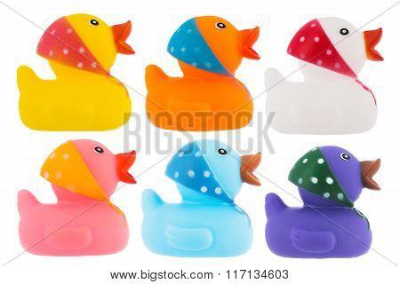 Many Ducks Toy Of Different Colors Over White