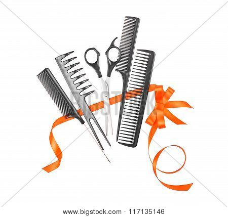 Hairdressing Tools Wrapped In A Red Ribbon Isolated On White Background
