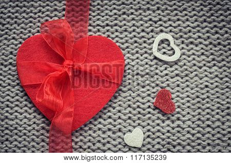 Red Felt Heart And  Colorful Decorative  Hearts With Woollen Texture In The Background.