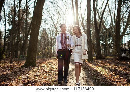 Ukrainian Brides In Traditional Costumes Embroidered Shirts Outdoors Walking In The Park