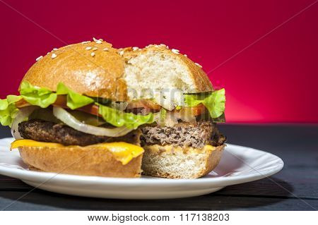 Tasty hamburger with lettuce, ham and cheese