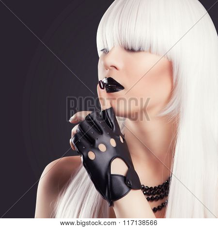 Beautiful Blonde Woman With Black Make-up And Accessories Making A Hush Gesture