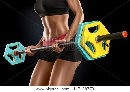 Young Woman Exercises With Barbell Isolated Over Black Background