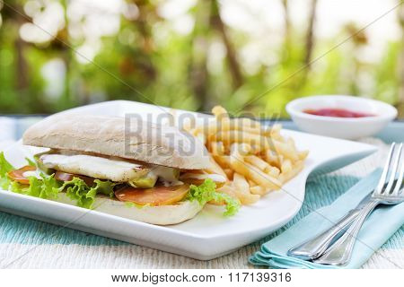 Vegetarian Ciabatta with tomatoes, grilled cheese haloumi, avocado and lettuce with french fries on