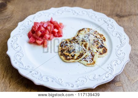 Ricotta Pancakes With Parmesan Cheese And Tomatoes Salad On Plate Over Wooden Background