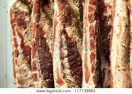 Sides Of Smoked Bacon In A Butchery
