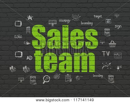 Marketing concept: Sales Team on wall background
