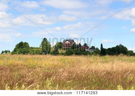 House On Top Of A Hill With Meadow In Saxon Switzerland