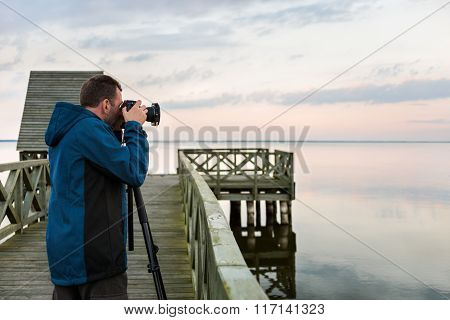 Nature Photographer Taking Photos Of The Lake At Sunset