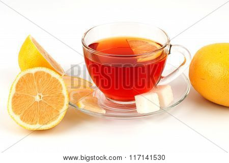 Glass Cup Of Tea Surrounded By Lemons.