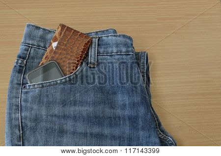 Leather Wallet And Smart Phone In Jeans Pocket