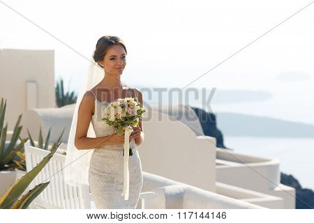 Beautiful Brunette Bride Walking To Wedding Aisle With Roses Bouquet