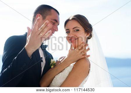 Newlywed Husband And Wife Kissing Sea Background Closeup, Santorini