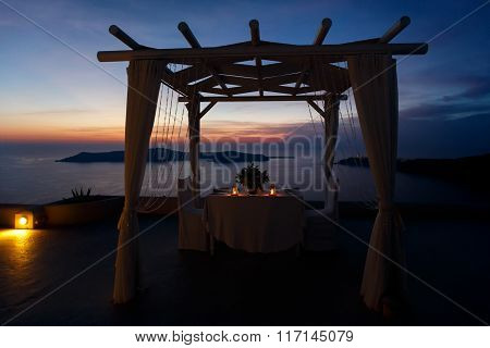 Wedding Tent Table And Chairs Lit With Candles In Lanterns Sea Background