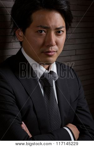 Dark And Serious Asian Male Portrait