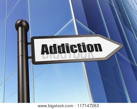 Medicine concept: sign Addiction on Building background