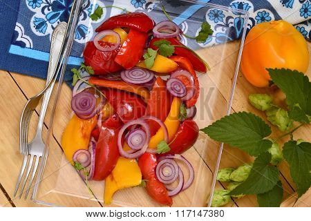Roasted red and yellow bell pepper with purple onion