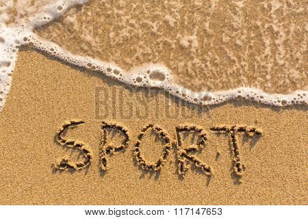 Sport - word drawn on the sand beach with the soft wave.