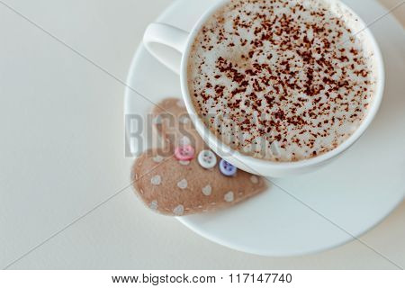 Beautiful Coffee Cup With Heart On A White Wooden Background