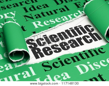 Science concept: black text Scientific Research under the piece of  torn paper