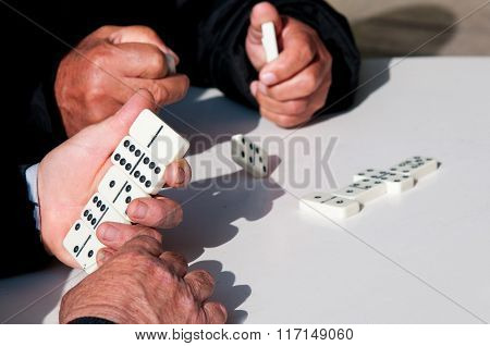 People  Playing Domino Game For Leisure
