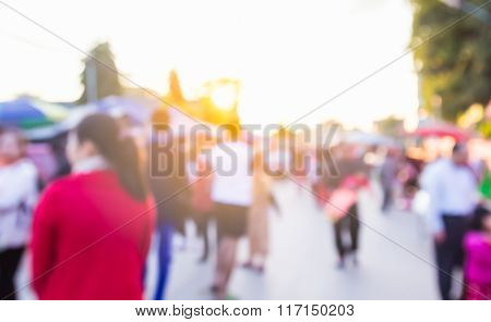 Abstract Blur Background Of People Shopping At Market Fair With Sunlight