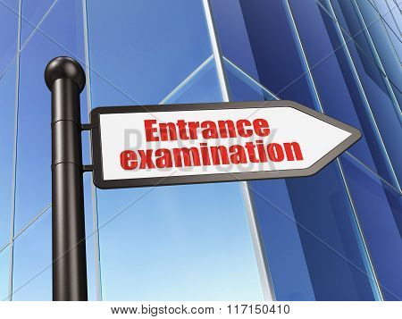Studying concept: sign Entrance Examination on Building background