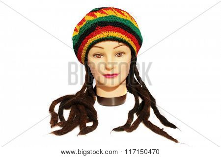 A female Hair Dressers Mannequin Head wears a Rastafarian Hat with Dreadlocks.  Isolated on white with room for your text.