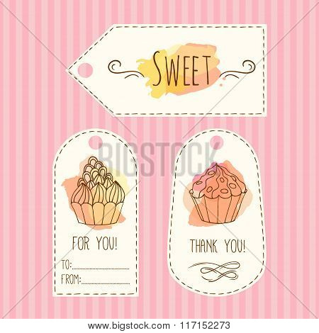 Tags with cupcake illustration. Vector hand drawn labes set with watercolor splashes.
