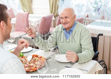 Cheerful family has a lunch in cafe