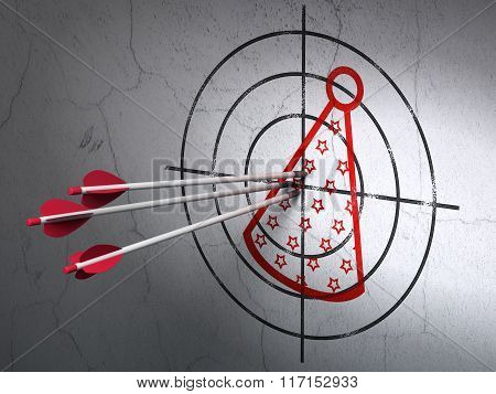 Entertainment, concept: arrows in Party Hat target on wall background