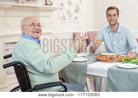 Two men have a family diner in cafe