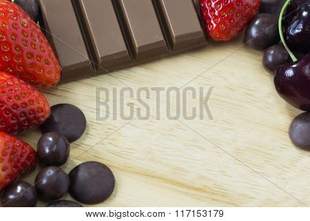 Chocolate And Strawberry On Wood Background And Space For Your Design