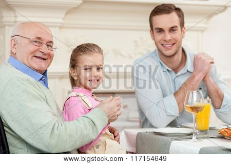 Cute friendly family is dining together