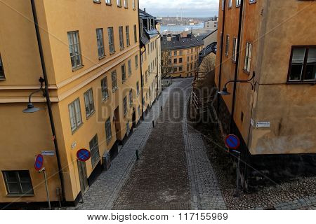 Narrow Cobblestone Alley And Old Houses In Central Stockholm