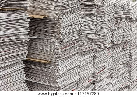 Newspaper Stacks In Warehouse