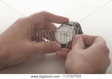 Man Winding His Wrist Watch
