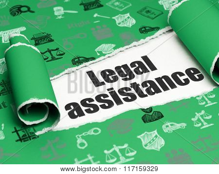 Law concept: black text Legal Assistance under the piece of  torn paper