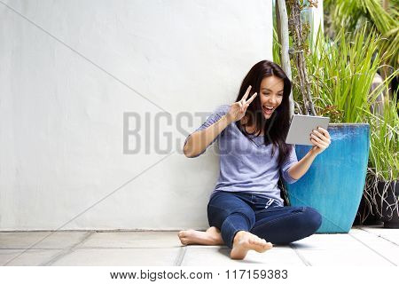 Smiling Young Woman Making Video Call Using Digital Tablet