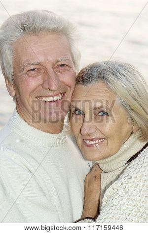 Elderly couple  near lake