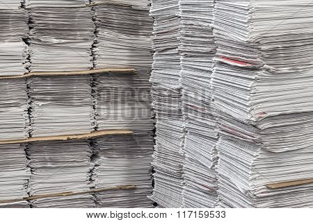 Stacked Bundles Of Newspapers