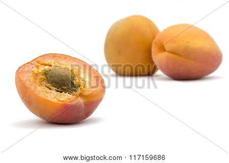 Apricots, Half And Whole Isolated On A White Background