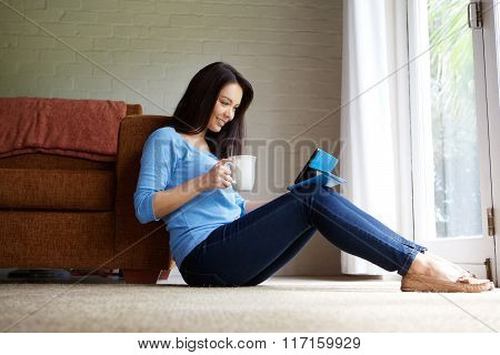 Young Woman Relaxing With Digital Tablet At Home