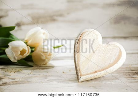 Heart Of Wood And Tulips On A White Painted Wooden Background, Rustic Romance Concept