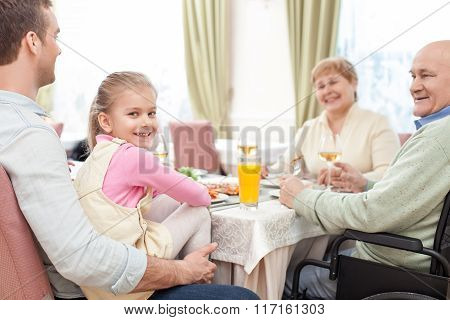 Pretty relatives have a lunch in cafe