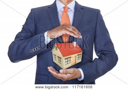 Man protecting house