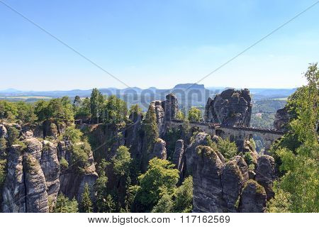 Panorama With Bastei Bridge, Neurathen Castle And Table Mountain Lilienstein In Rathen, Saxon Switze