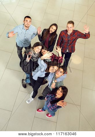 Group of students in the hall of the university, view from above. Selective focus
