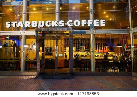 SHENZHEN, CHINA - FEBRUARY 05, 2016: facade of Starbucks Cafe. Starbucks Corporation is an American global coffee company and coffeehouse chain based in Seattle, Washington