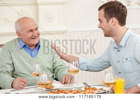 Cute friendly family is dining at home